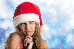Woman in a Christmas cap Stock Photos