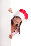 Woman in Christmas cap and blank Stock Photography
