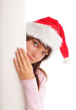 Woman in Christmas cap and blank in hands Stock Photo