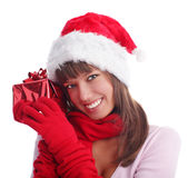 Woman in a Christmas cap with a gift Royalty Free Stock Photo
