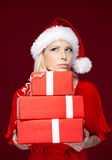 Woman in Christmas cap hands a set of presents Stock Photo