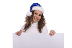 Woman in Christmas cap holding blank informational Stock Photo