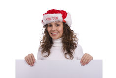 Woman in Christmas cap holding blank informational Royalty Free Stock Image