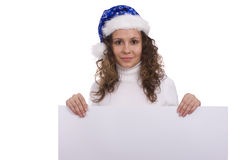Woman in Christmas cap holding blank informational Royalty Free Stock Images