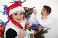 Woman with Christmas cap Royalty Free Stock Images
