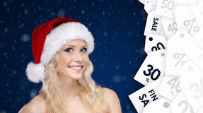 Woman in Christmas cap offer big discount on gifts Royalty Free Stock Photo