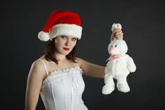 Woman in Christmas cap with white rabbit Stock Photography