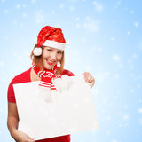 Woman with christmas card on snowfall background Royalty Free Stock Image