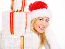 Woman in christmas clothes holding present Royalty Free Stock Photography