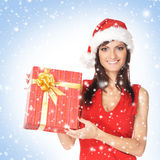 A woman in Christmas clothes holding a present Stock Photography
