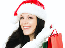 Woman in christmas clothes holding shopping bags Stock Image