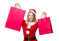 Woman with christmas costume holding shopping bag. Isolated on white background Stock Photos