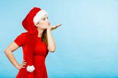 Woman christmas costume sending kisses Royalty Free Stock Images