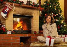 Woman in Christmas decorated house interior Royalty Free Stock Photos