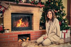 Woman in Christmas decorated house interior Stock Photo