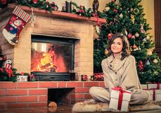 Woman in Christmas decorated house interior Royalty Free Stock Photography