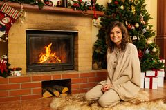 Woman in Christmas decorated house Stock Photos