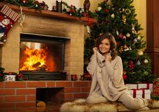 Woman in Christmas decorated house Stock Image