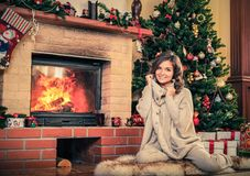 Woman  in Christmas decorated house Stock Photo