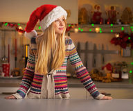 Woman in christmas decorated kitchen looking on co Royalty Free Stock Photography