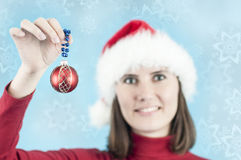 Woman with a Christmas decoration Stock Photo
