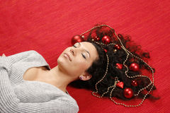 Woman with christmas decorations Royalty Free Stock Photos