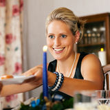 Woman at Christmas Dinner Royalty Free Stock Image