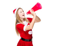 Woman with Christmas dress yell with megaphone Royalty Free Stock Photography