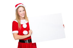 Woman with christmas dressing and blank billboard Stock Image