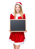 Woman with christmas dressing and hold with chalkboard Royalty Free Stock Images