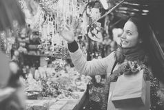 Woman at Christmas fair in evening Royalty Free Stock Images