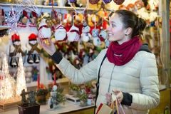 Woman at Christmas fair in evening Stock Images