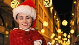 Woman at Christmas in Florence, Italy wrapping up in red scarf Stock Photo