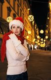 Woman at Christmas in Florence, Italy wrapping up in red scarf Royalty Free Stock Photos