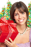Woman with a Christmas gift Stock Images