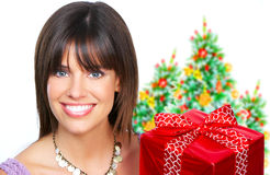 Woman with a Christmas gift Royalty Free Stock Images