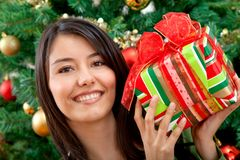 Woman with Christmas gift Stock Image