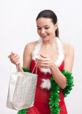 Woman with christmas gift Royalty Free Stock Photography