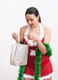 Woman with christmas gift Stock Photos