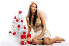 Woman on christmas with a gift Royalty Free Stock Image