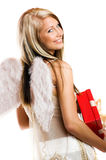 Woman on christmas with a gift Royalty Free Stock Photos