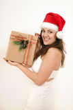 Woman with a Christmas gift Royalty Free Stock Image