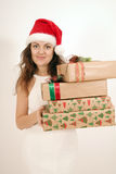Woman with a Christmas gift Stock Photos
