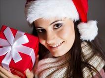 Woman with christmas gift Stock Image