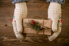 Woman with a Christmas gift in hand Stock Images