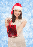 Woman with Christmas gift Royalty Free Stock Photo