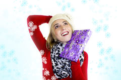 Woman with christmas gift - snowflake Stock Image