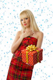 Woman with christmas gift. Snowflakes Stock Photos