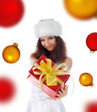 Woman the christmas gift on a spheres background Royalty Free Stock Image