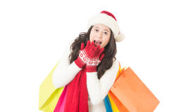 Woman Christmas gift surprised and happy hand on mouth. Young beautiful smiling woman in Santa hat. Funny cute photo of Asian woman isolated on white Stock Photo